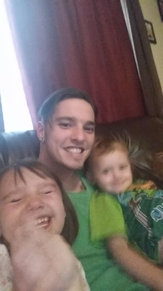 My kids taking pictures with me on the couch