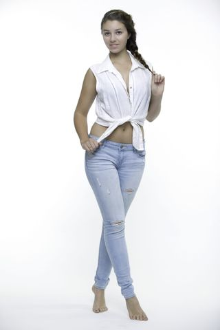 Full Length casual model pose with tight jeans and belly button shirt.