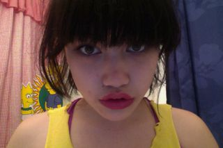 Trying out a new makeup look, attempting to make my lips look bigger.