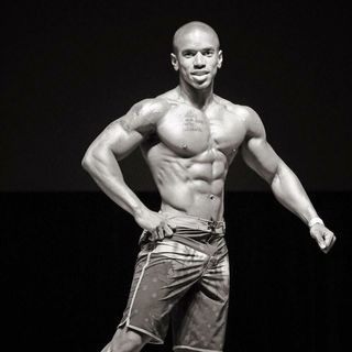 Posing before competing for men's physique bodybuilding